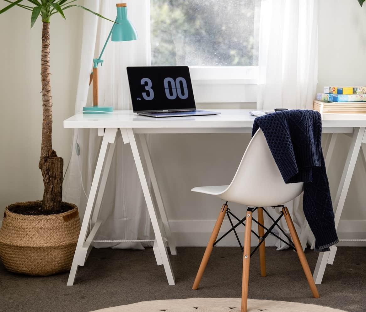 Home desk in front of window