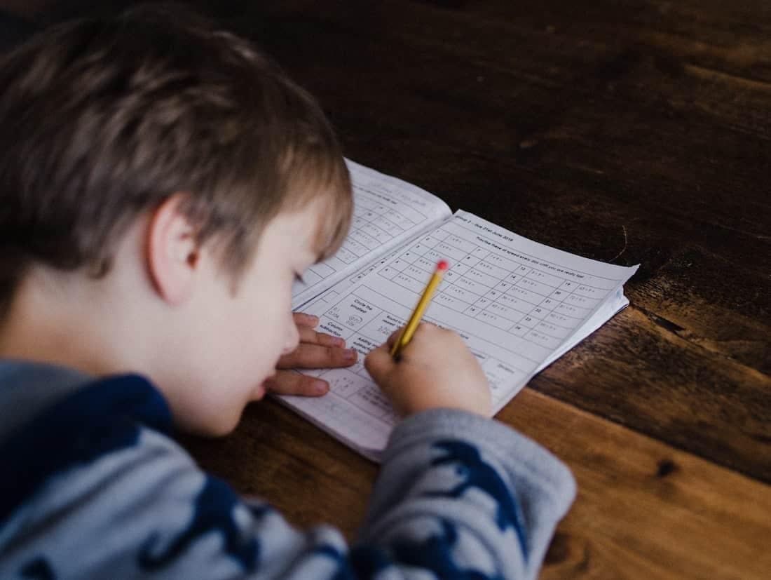 Child writing in workbook