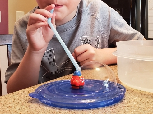 child doing a science experiment